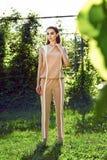 Beautiful sexy woman wearing dress walk in the park sun shine Royalty Free Stock Image