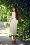 Beautiful sexy woman wearing dress walk in the park sun shine Stock Image