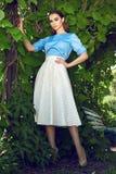 Beautiful sexy woman wearing dress walk in the park sun shine Stock Photos