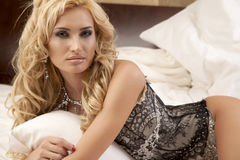 Beautiful and woman wearing elegance lingerie. Portrait of a beautiful attractive and sensuality young adult pretty blonde woman wearing elegance fashionable royalty free stock photos