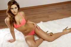 Beautiful and sexy woman wearing pink lingerie Stock Photos