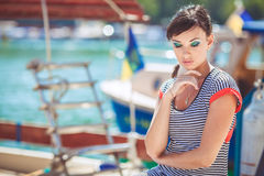 Beautiful sexy woman wearing sailor striped dress posing at the sea Stock Photo