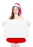 Beautiful sexy woman wearing santa claus clothes with blank sign Royalty Free Stock Photography