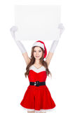 Beautiful sexy woman wearing santa claus clothes with blank sign Royalty Free Stock Photos