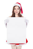 Beautiful sexy woman wearing santa claus clothes with blank sign Royalty Free Stock Photo
