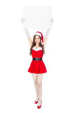 Beautiful sexy woman wearing santa claus clothes with blank sign Stock Photo