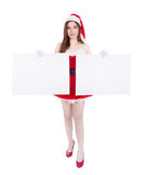 Beautiful sexy woman wearing santa claus clothes with blank sign Stock Photos