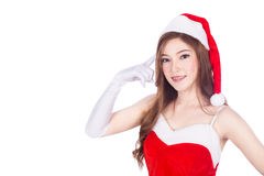 Beautiful sexy woman wearing santa claus clothes and thinking is Stock Photography