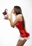 Beautiful and sexy woman wearing santa clause. Costume holding santa clause Stock Images
