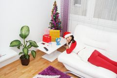 Beautiful and sexy woman wearing santa clause costume Stock Photos