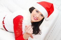 Beautiful and sexy woman wearing santa clause costume Royalty Free Stock Images