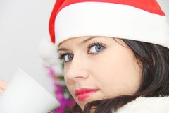 Beautiful and sexy woman wearing santa clause costume Stock Image