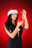 Beautiful and sexy woman wearing santa clause costume Stock Images