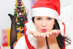 Beautiful and sexy woman wearing santa clause costume Stock Photo