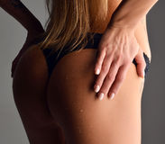 Beautiful sexy woman wet ass butts with water drops and blonde h Royalty Free Stock Photo