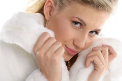 Beautiful sexy woman in white coat Royalty Free Stock Photo