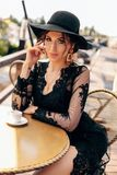 Beautiful Sexy Woman With Dark Hair In Elegant Black Dress And Hat Royalty Free Stock Image