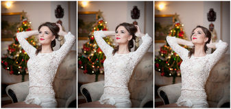 Beautiful woman with Xmas tree in background sitting on elegant chair in cozy scenery. Portrait of girl posing pretty Royalty Free Stock Photos