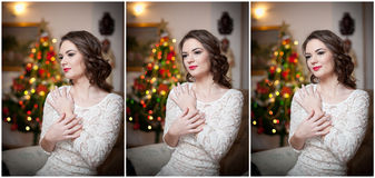 Beautiful sexy woman with Xmas tree in background sitting on elegant chair in cozy scenery. Portrait of girl posing pretty Royalty Free Stock Photography