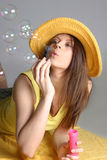 Beautiful woman in yellow hat.  royalty free stock photo