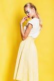 Beautiful sexy woman in yellow skirt Royalty Free Stock Photo