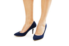 Beautiful, sexy, women's legs in blue shoes Stock Photography