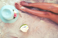 Beautiful of sexy women tan. relax on sandy beach with hat and coconut cocktail. Leisure in summer - Beautiful of sexy women tan. relax on sandy beach with hat Royalty Free Stock Photography