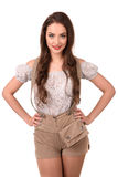 Beautiful sexy young brunette girl in traditional German costume Stock Photos