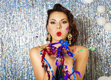 Beautiful sexy young brunette woman holding palms with sequins Royalty Free Stock Photography