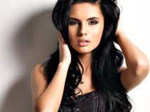 Beautiful young brunette woman with long hair royalty free stock photo