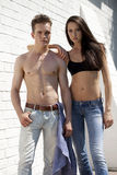 Beautiful sexy young couple in blue jeans Royalty Free Stock Photography