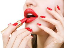 Beautiful young girl holding red lipstick, bright make-up. stock photos
