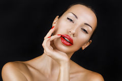 Beautiful Sexy Young Girl with Red Lips, Bright Make-up on Dark Stock Photography