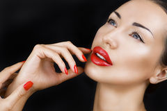 Beautiful Sexy Young Girl with Red Lips, Bright Make-up on Dark Stock Image