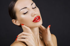 Beautiful Sexy Young Girl with Red Lips and Red Nail Polish, Bri Royalty Free Stock Images
