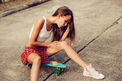 Beautiful sexy young lady in erotic mini skirt with a skateboard Stock Photo
