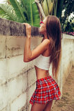 Beautiful sexy young lady in erotic mini skirt trying to get ove Royalty Free Stock Photos