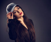 Beautiful young make-up model in blue baseball cap with red Royalty Free Stock Photos