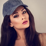 Beautiful sexy young make-up model with brown hair posing in blu Stock Image