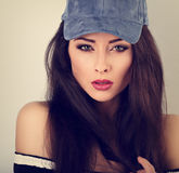 Beautiful young make-up model posing in blue baseball cap w Stock Images