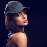 Beautiful young make-up model profile in blue baseball cap Stock Image