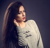 Beautiful sexy young make-up model with red lipstick posing in g Royalty Free Stock Photos
