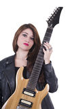 Beautiful sexy young musician girl holding. Electric guitar isolated on white Stock Photo