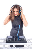 Beautiful Sexy Young Woman as DJ playing music on (pickup) mixer. Isolated on a white background. Studio shot Royalty Free Stock Photos