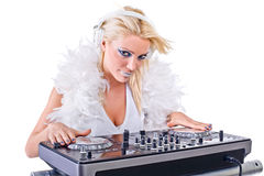 Beautiful Young Woman as DJ playing music on (pickup) mixer. Royalty Free Stock Images