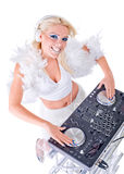 Beautiful Sexy Young Woman as DJ playing music on (pickup) mixer. Isolated on a white background. Studio shot Royalty Free Stock Photography