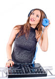 Beautiful Sexy Young Woman as DJ playing music on (pickup) mixer. Isolated on a white background. Studio shot Stock Image