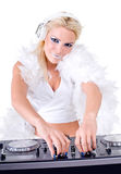 Beautiful Sexy Young Woman as DJ playing music on (pickup) mixer. Isolated on a white background. Studio shot Stock Photo