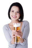 Beautiful and young woman with beer Stock Image