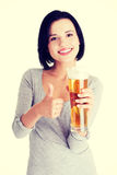 Beautiful and sexy young woman with beer Royalty Free Stock Photography
